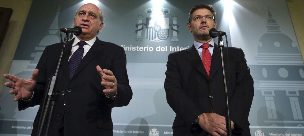 Foto: Los ministros de Justicia, Rafael Catalá (d), y de Interior, Jorge Fernández Díaz. (EFE)