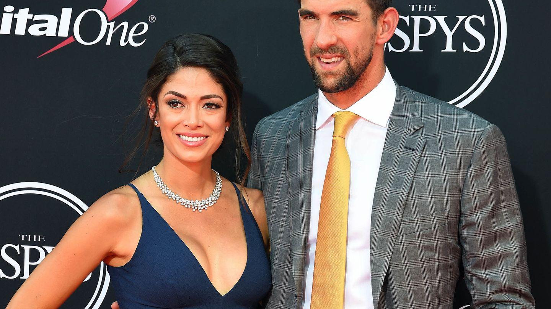 Michael Phelps y su mujer Nicole Johnson. (USA TODAY Sports)