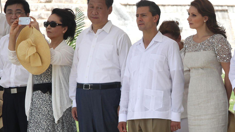 Peng, con su iPhone 5. (Reuters)