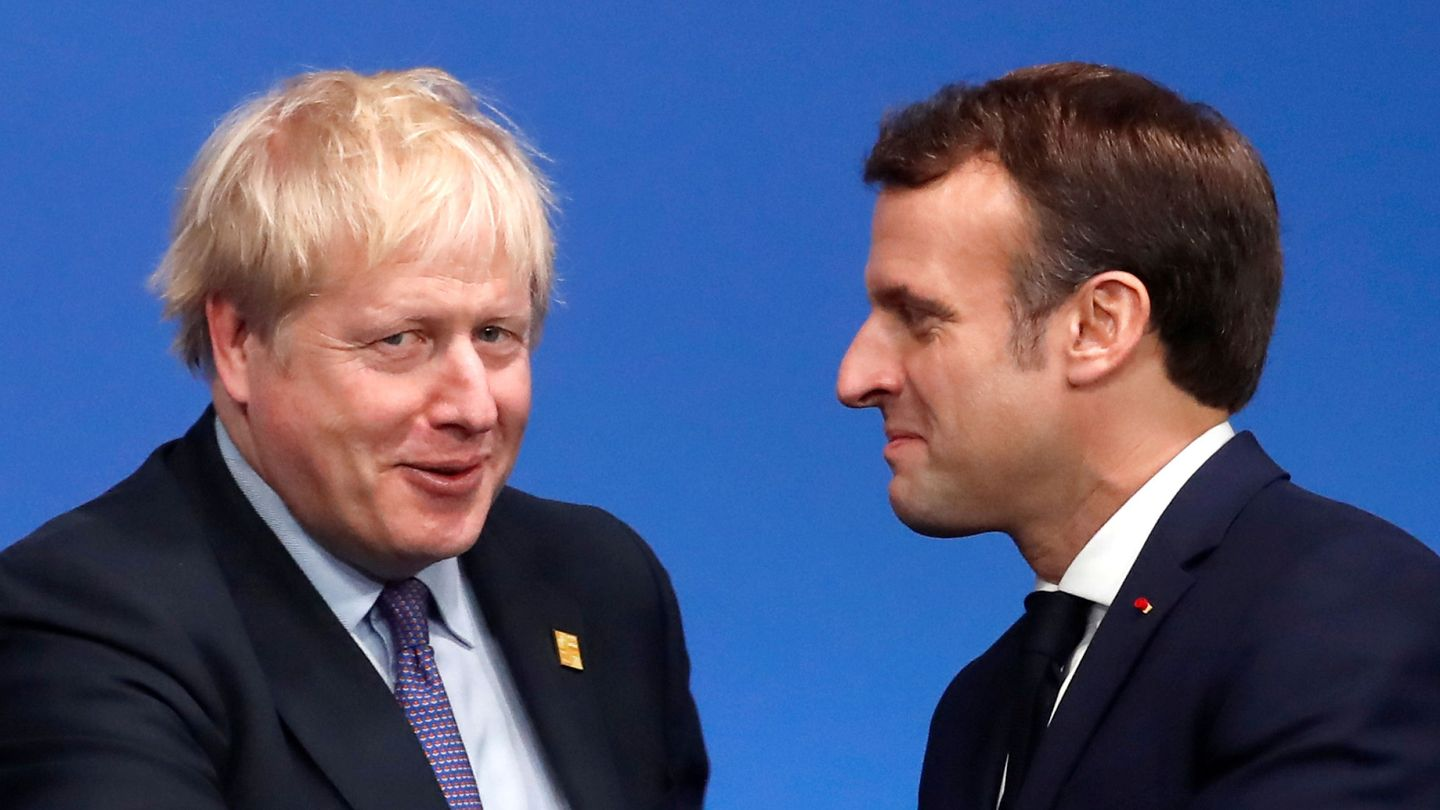 FILE PHOTO: Britain's Prime Minister Boris Johnson welcomes France's President Emmanuel Macron at a NATO leaders summit in Watford, Britain December 4, 2019. REUTERS Christian Hartmann File Photo