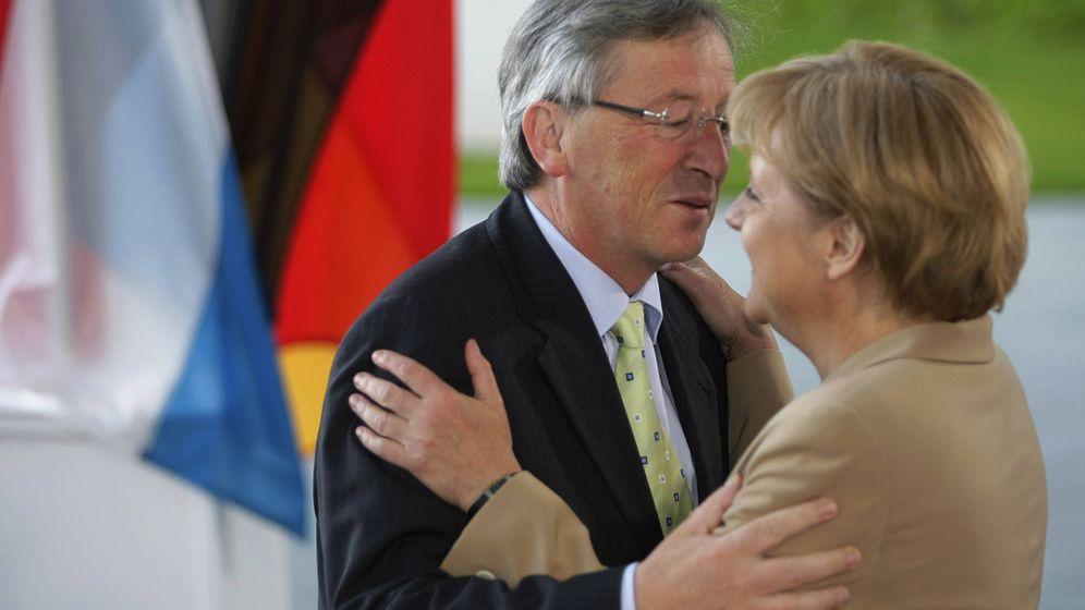 Foto: Jean-Claude Juncker y Angela Merkel. (Reuters)