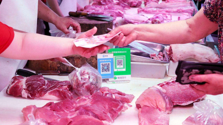 Foto: Una carnicería que acepta pagos con Wechat (Foto: Reuters)
