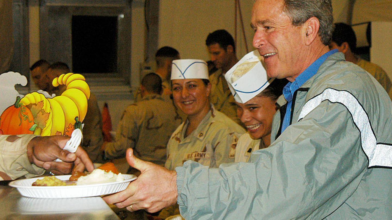 Bush, en Irak y en chándal. (Getty)