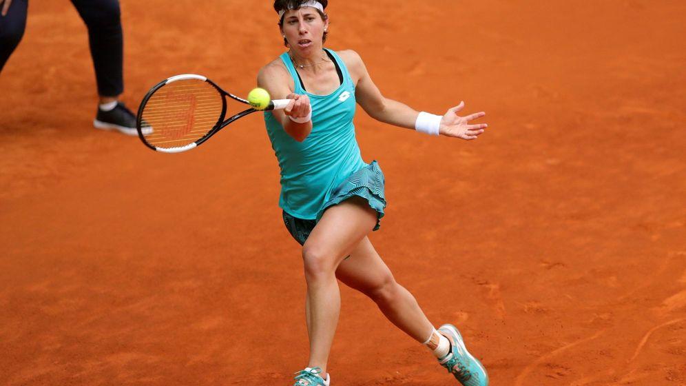 Foto: Carla Suárez disputando un partido en el Mutua Madrid Open de este año. (EFE)