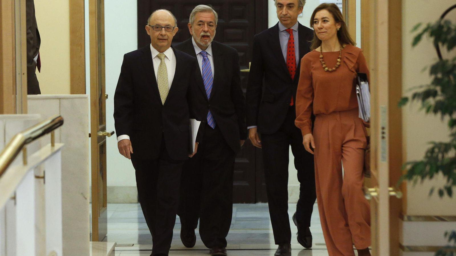 Foto: Cristóbal Montoro (i), Antonio Beteta (2i), Miguel Ferre (2d), y Marta Fernandez Currás. (EFE)