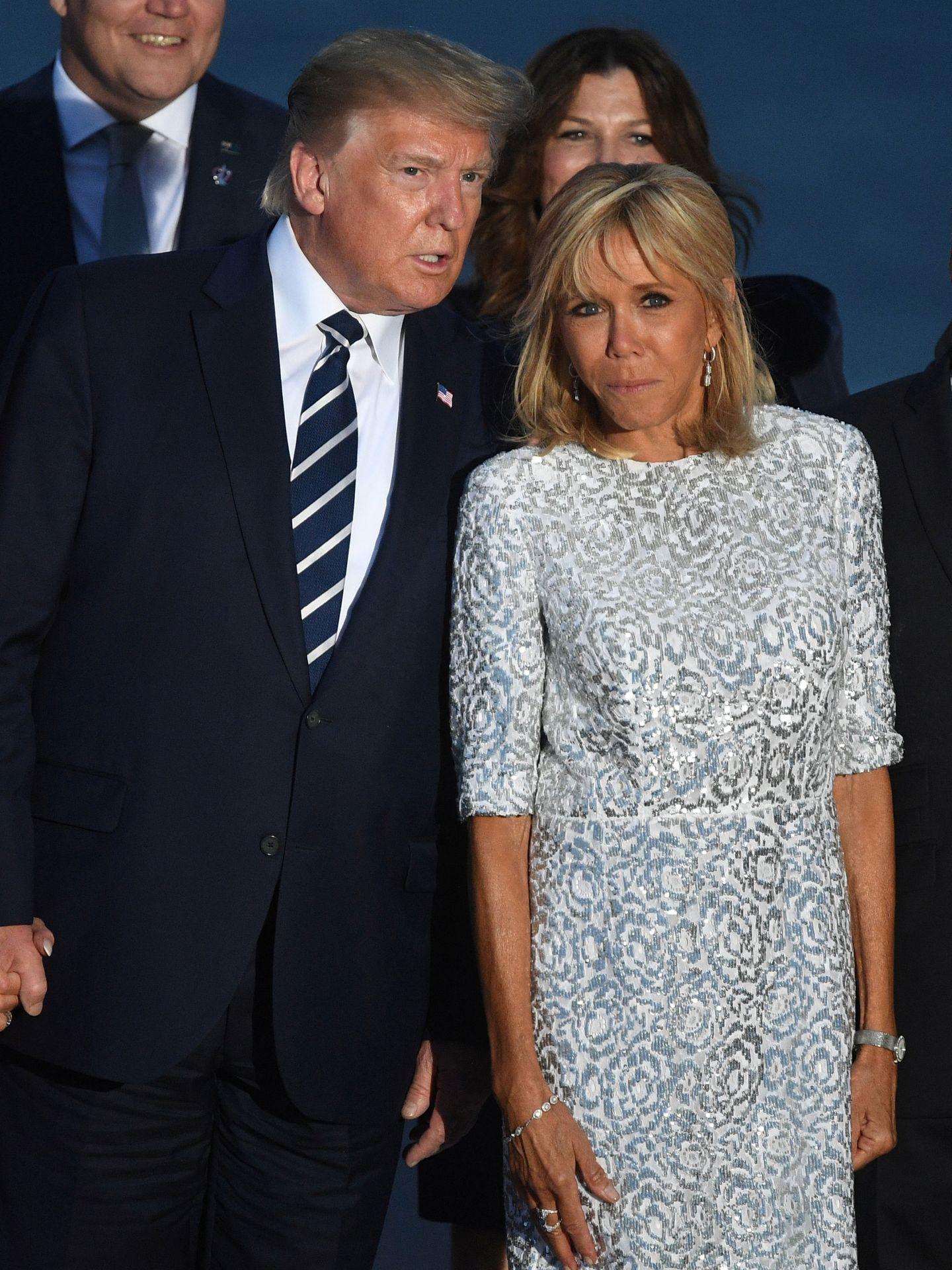 Donald Trump junto a Brigitte Macron.  (Reuters)