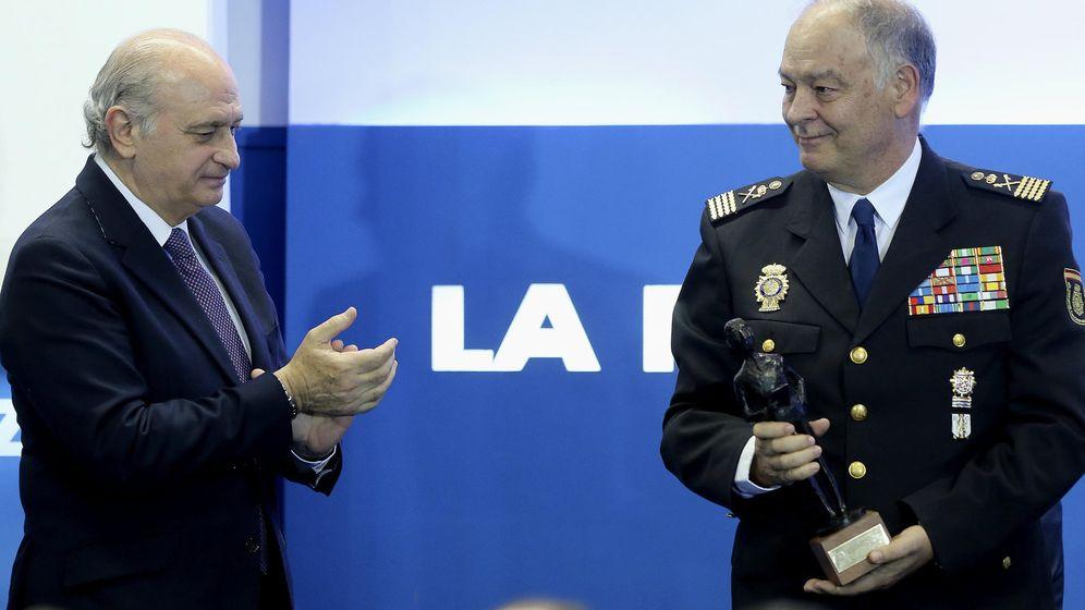 Foto: El ministro Jorge Fernández Díaz, junto al director adjunto operativo de la Policía, Eugenio Pino, a quien su compañero Marcelino Martín Blas ha pedido imputar. (EFE)