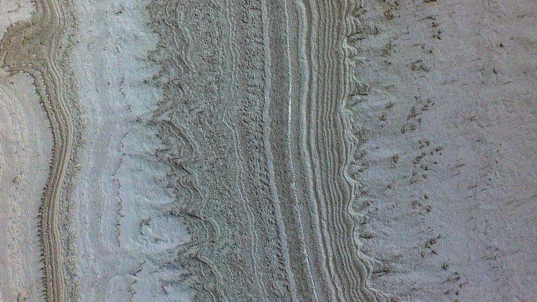 La esmectita está presente en las capas de hielo del polo sur de Marte. (NASA)
