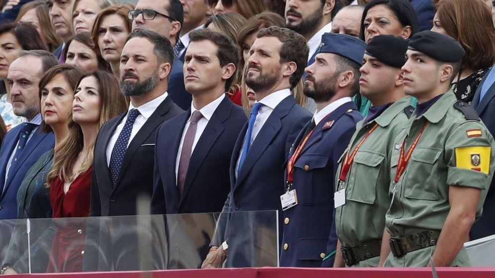 Foto: Santiago Abascal, Albert Rivera y Pablo Casado, candidatos de Vox, Cs y PP, en la Fiesta Nacional. (EFE)