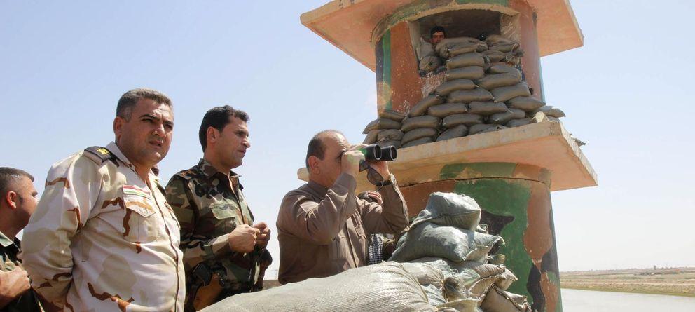 Foto: Las fuerzas kurdas vigilan este sábado el despliegue de tropas en Kirkuk. (Reuters)