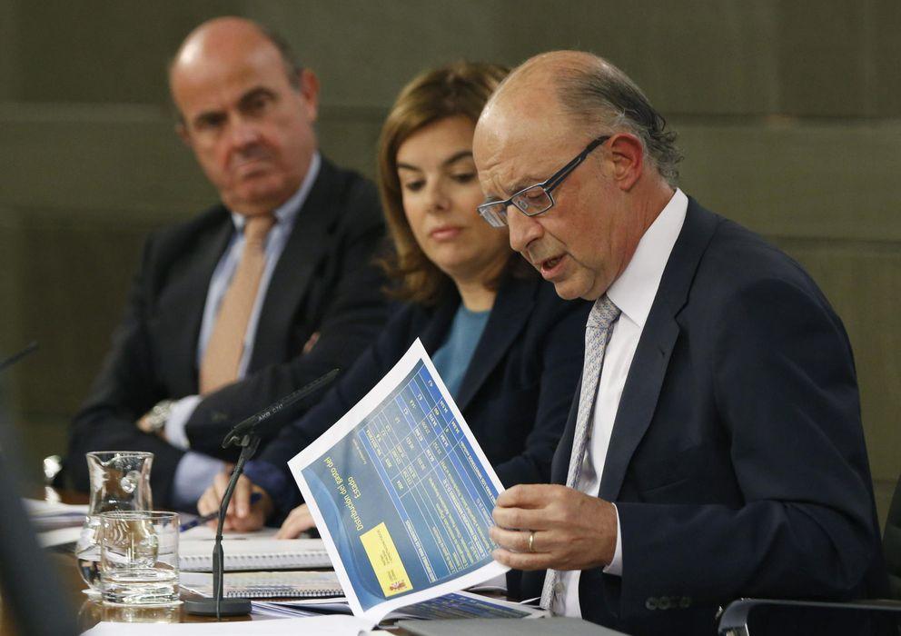 Foto: Guindos, Saénz de Santamaría y Montoro en rueda de prensa el pasado septiembre (EFE)