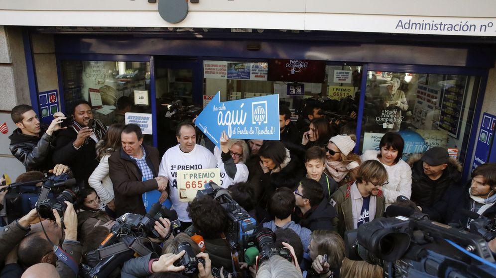 Foto: El número 66.513, premiado con el Gordo, fue vendido en una sucursal de Madrid. (EFE)