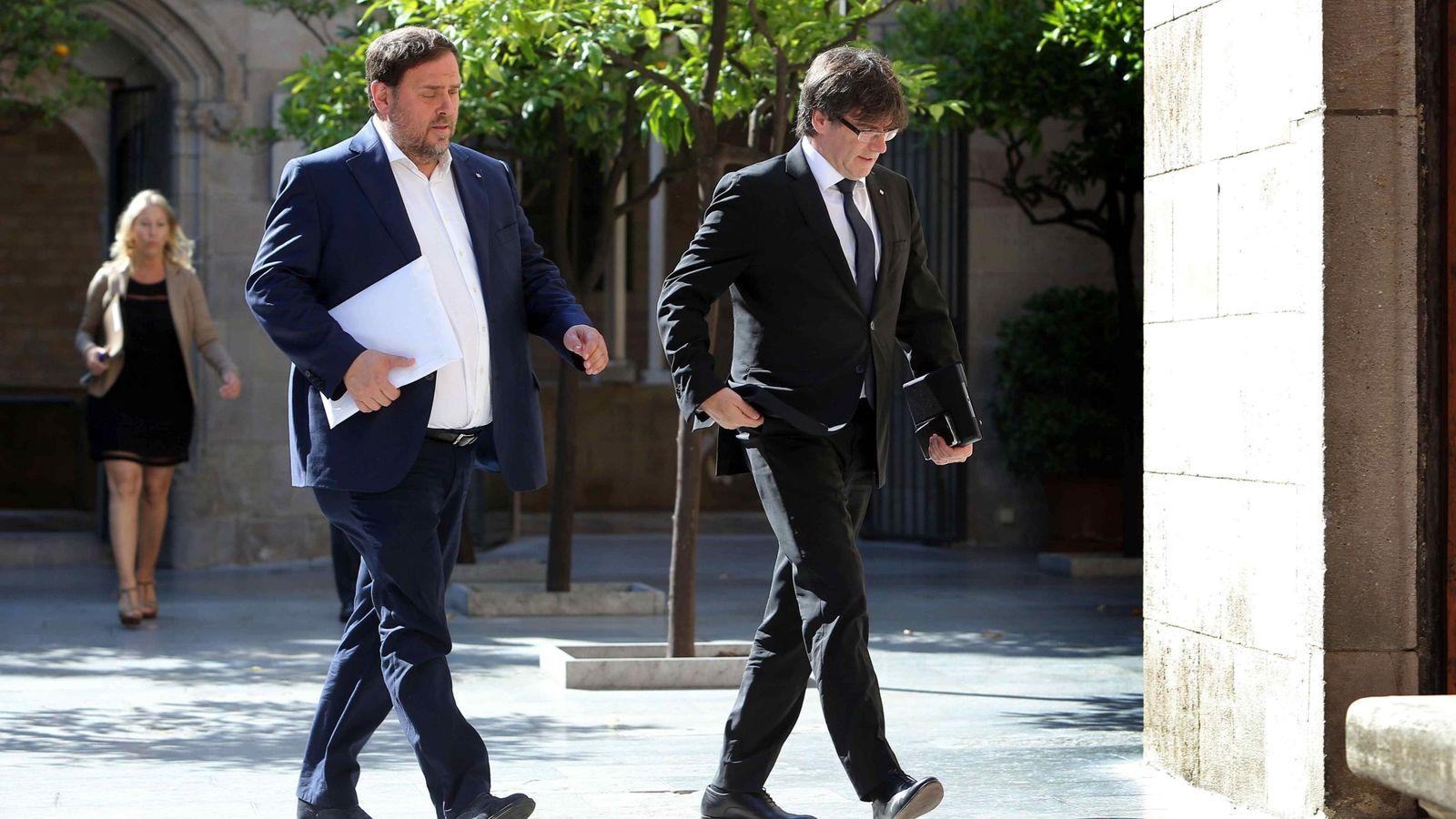Foto: El presidente de la Generalitat, Carles Puigdemont, y el vicepresidente, Oriol Junqueras. (EFE)