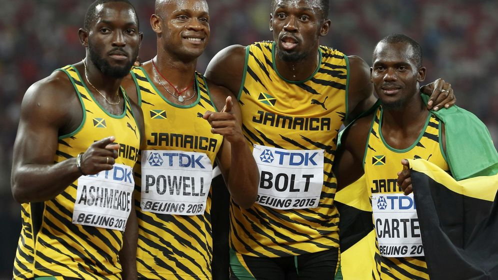 Foto: Ashmeade, Powell, Bolt and Carter of Jamaica react after winning the men's 4x100m relay during the 15th IAAF World Championships at the National Stadium in Beijing