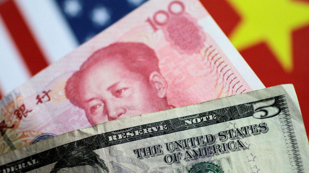 Foto: China fija por primera vez desde 2008 el cambio de su moneda por encima de los 7 yuanes por dólar