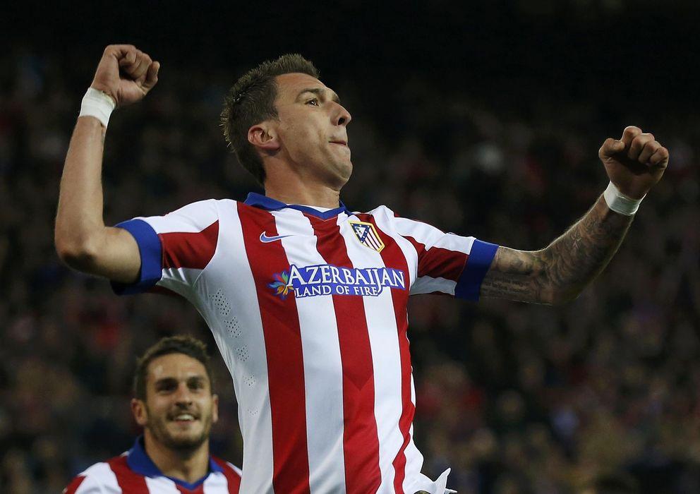 Foto: Mandzukic celebra uno de sus goles al Olympiacos (Reuters).