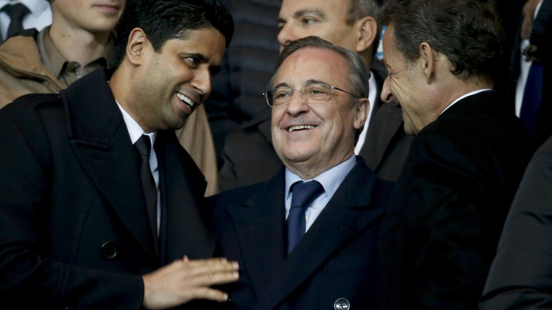 Florentino Pérez, entre Nasser Al-Khelaïfi y Nicolas Sarkozy. (Reuters)