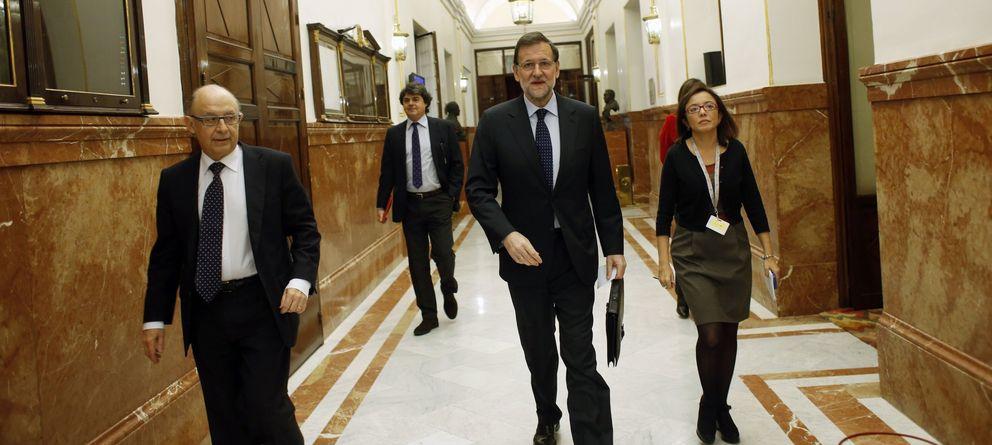 Foto: Cristóbal Montoro, junto a Mariano Rajoy. (Reuters)
