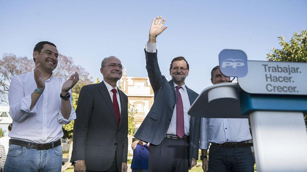 Foto: El presidente del Gobierno, Mariano Rajoy (2d), junto al presidente del PP en Andalucía, Juanma Moreno (i); el alcalde de Málaga, Francisco de la Torre (2i). (EFE)