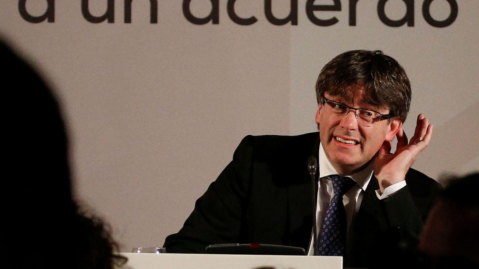 Foto: El presidente de la Generalitat, Carles Puigdemont, durante su intervención en la conferencia 'Un referéndum para Cataluña. Invitación a un acuerdo democrático', en Madrid. (EFE)