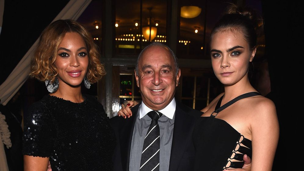 Foto: Sir Philip Green, junto a Beyoncé y Cara Delevingne. (Getty)