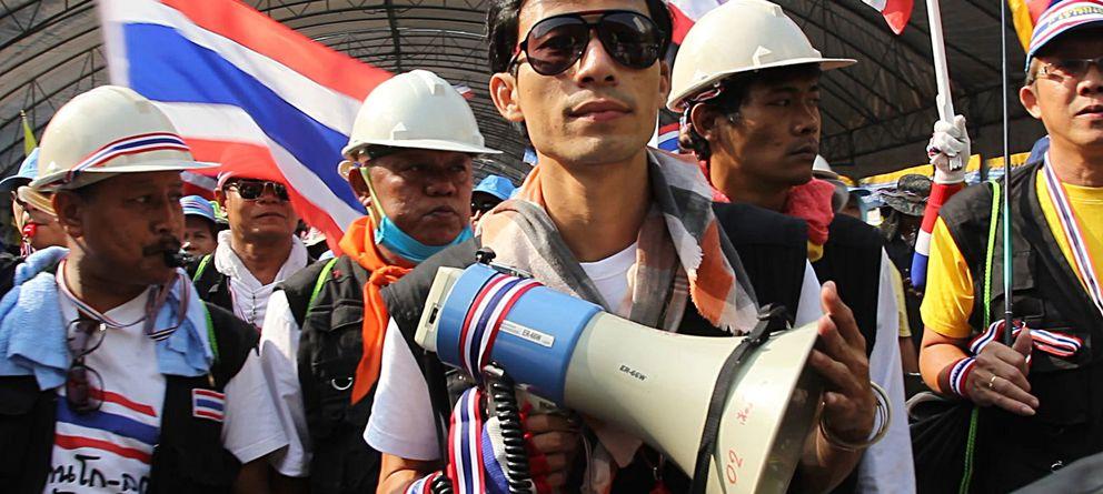 Los patriotas que vienen de lejos: un pueblo viaja 30 horas para cambiar Tailandia
