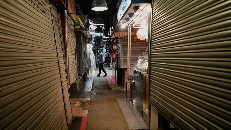 Escasa actividad en el Mercado de la Boquería de Barcelona. Vea aquí más fotos.