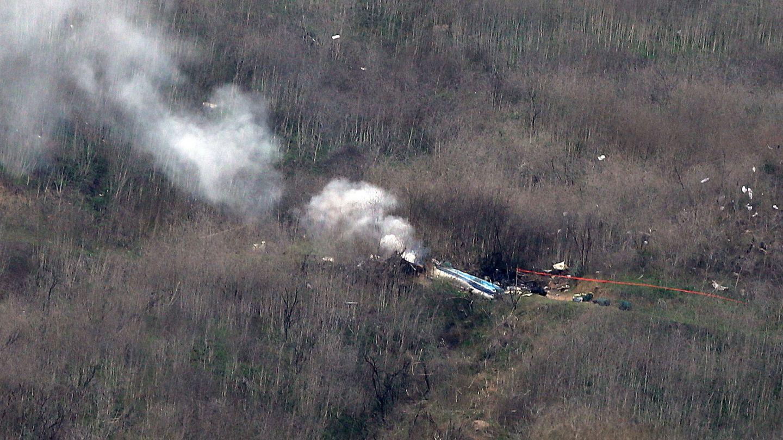 Los restos del helicóptero accidentado. (EFE)