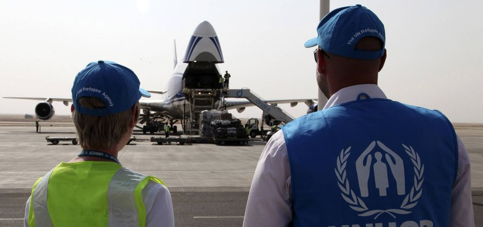 Foto: Trabajadores de la ONU supervisan la descarga de ayuda humanitaria en Erbil, Irak, en agosto de 2014. (Reuters)