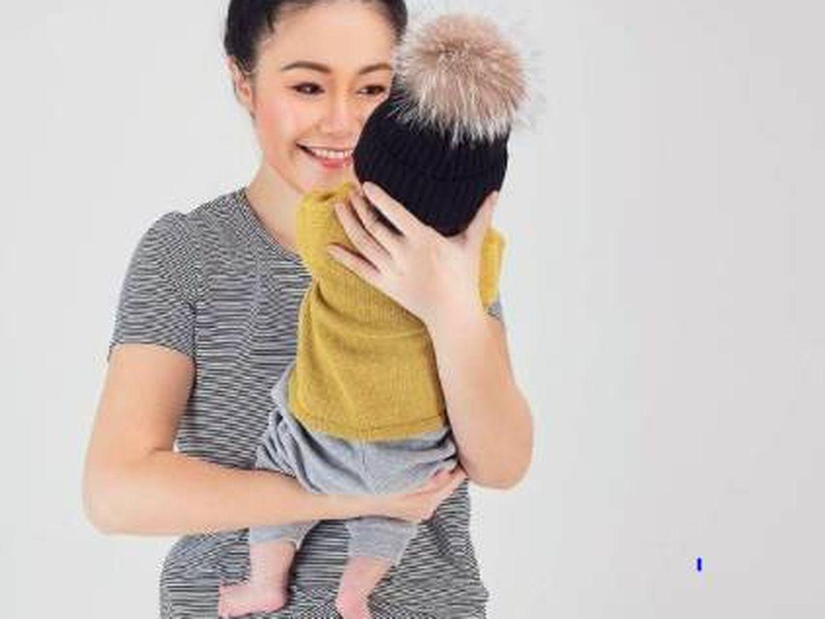 Foto: Lili Luo con su bebé. (IG)