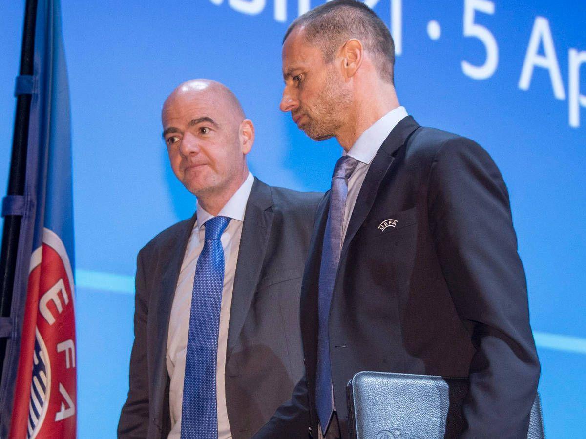 Foto: Gianni Infantino, presidente de la FIFA, junto a Aleksander Ceferin, presidente de la UEFA. (EFE)