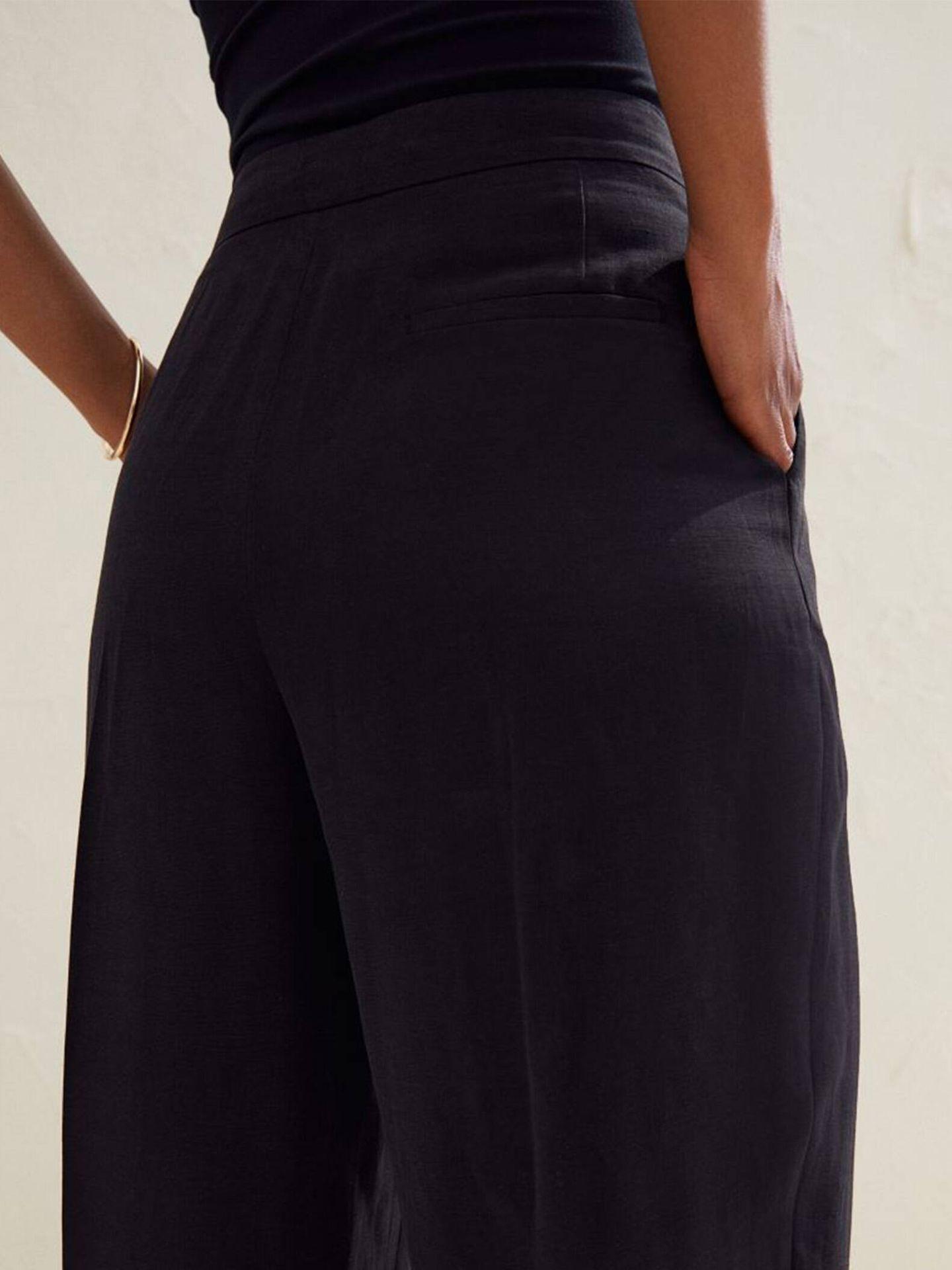 Pantalón de vestir negro, fresquito y atemporal de HyM. (Cortesía)