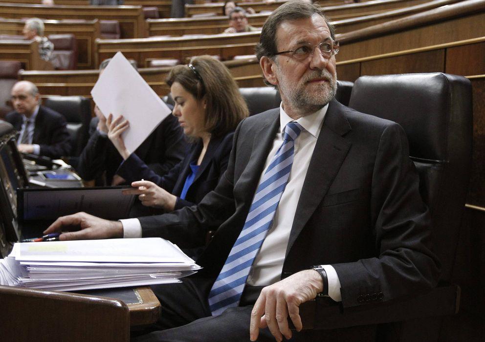 Foto: Mariano Rajoy y Soraya Sáenz de Santamaría, en el debate del estado de la nación en febrero de 2013. (EFE)