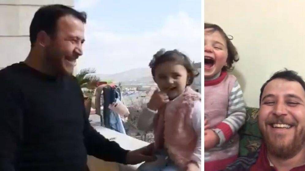 Siria: un padre enseña a su hija a reírse de los bombardeos