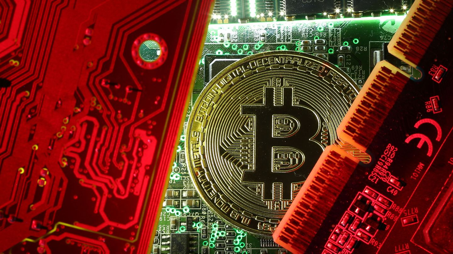 A copy of bitcoin standing on PC motherboard is seen in this illustration picture, October 26, 2017. Picture taken October 26, 2017. REUTERS Dado Ruvic