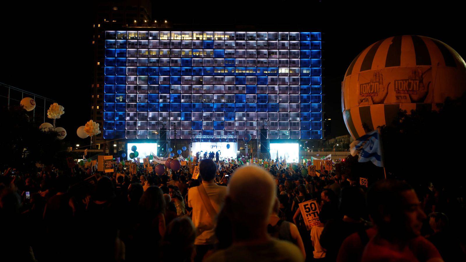"""Foto: Israelíes durante el evento """"Dos estados, una esperanza"""", que protesta contra la ocupación, en Tel Aviv. (Reuters)"""