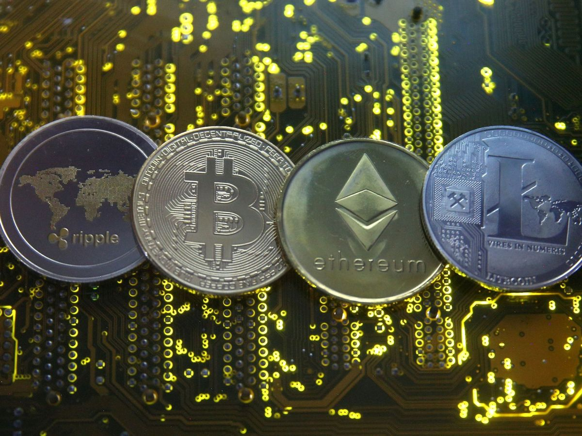 Photo: Representations of several cryptocurrencies: Ripple, Bitcoin, Ethereum and Litecoin. (Reuters)