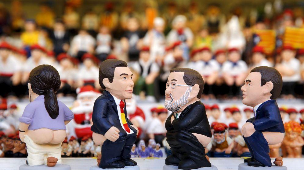 Foto: Muñecos de los líderes de los cuatro partidos más votados en España. (Reuters)