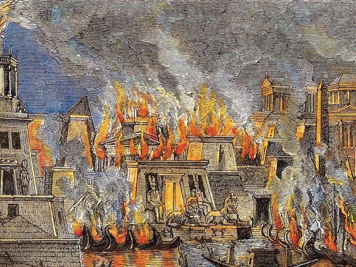 Foto: Grabado de 1876 que recrea el supuesto incendio que habría destruido parte de la Biblioteca de Alejandría en el 47 a.C.