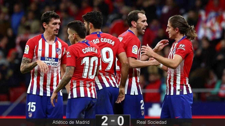 Foto: Godín y Filipe Luis, a la izquierda en la imagen, marcaron los dos goles del Atlético. (EFE)
