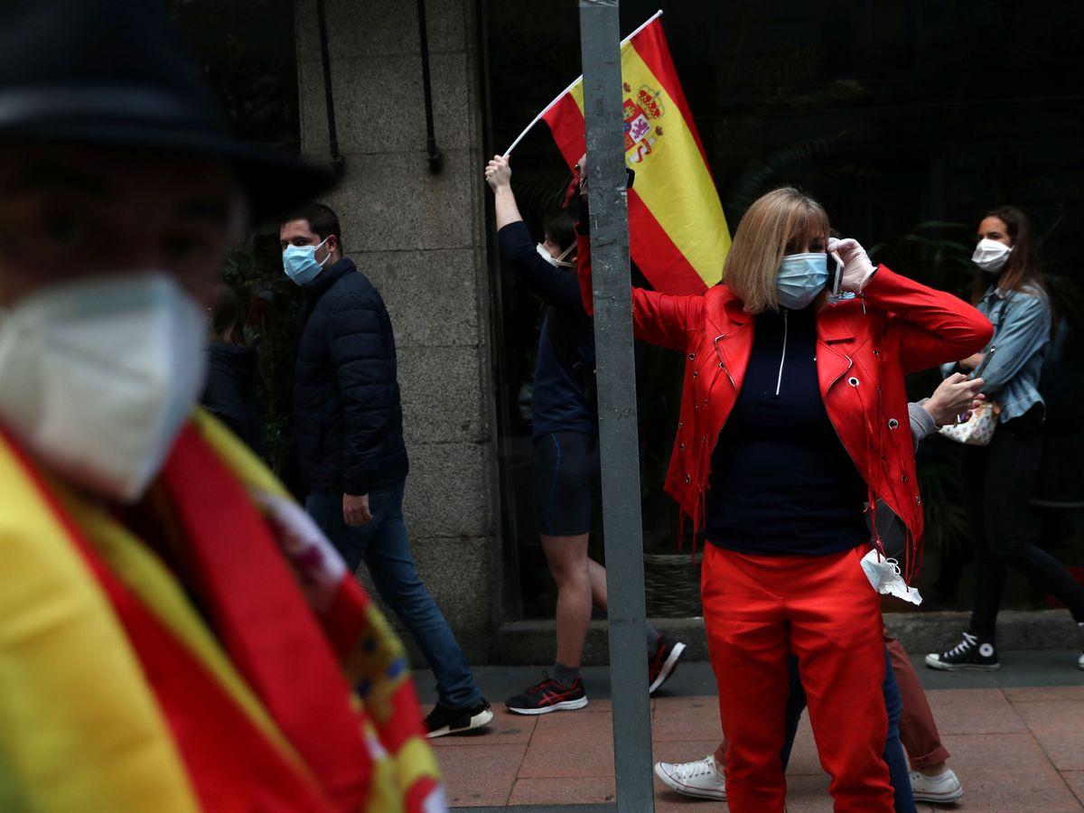 Foto: Una mujer protesta en Madrid. (Reuters)