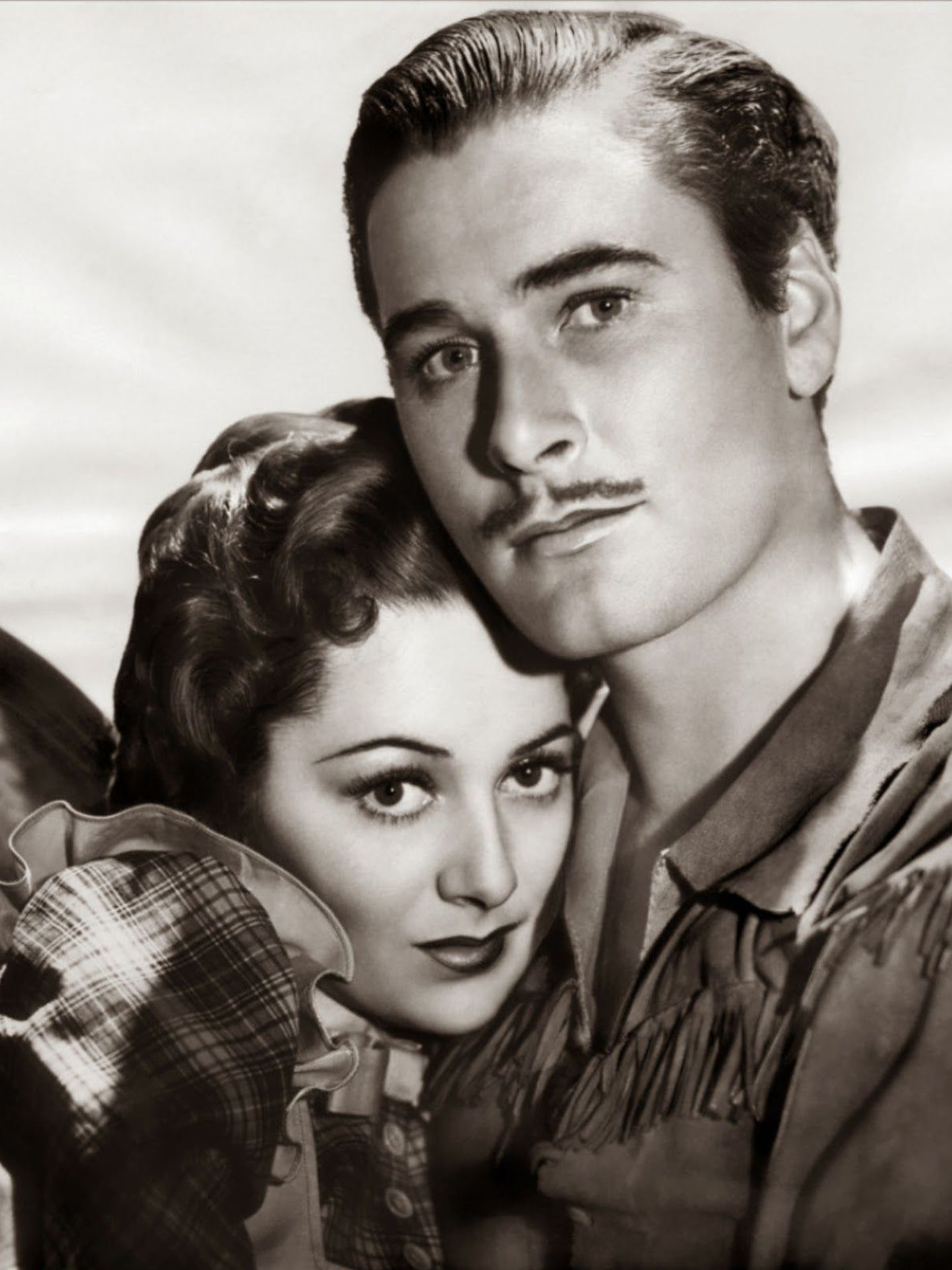 Errol Flynn y Olivia de Havilland en 'Dodge, ciudad sin ley'. (Warner)
