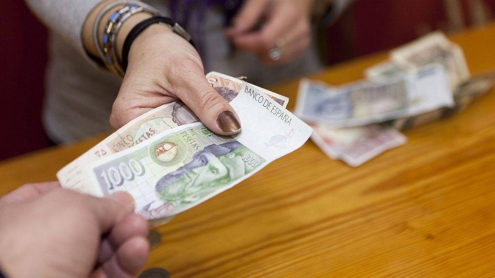 Foto: Billetes de 1.000 pesetas en un pueblo de Cuenca en 2012. (EFE)