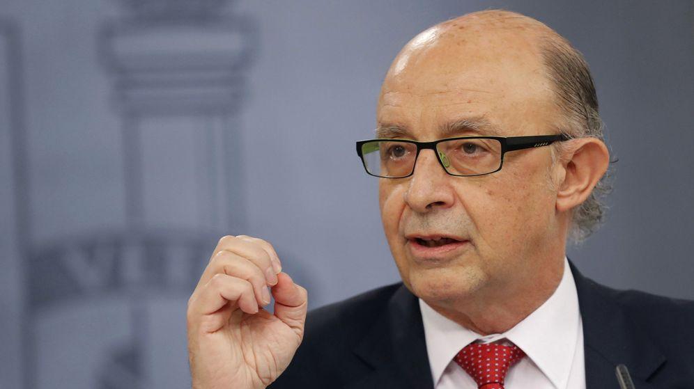 Foto: El ministro de Hacienda, Cristóbal Montoro, en la rueda de prensa en que anunció la subida de impuestos. (EFE)