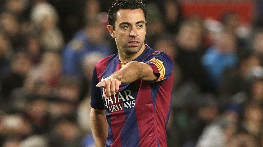 Foto: Xavi Hernández durante un partido del Barcelona (Efe).