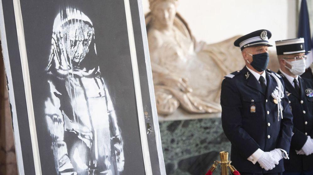 Foto: Exposición del mural antes de ser devuelto a Francia. (EFE)