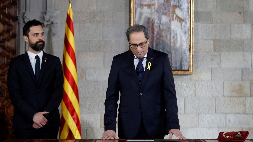Foto: Quim Torra, en el momento de la toma de posesión de su cargo, este 17 de mayo en el Palau de la Generalitat. (Reuters)
