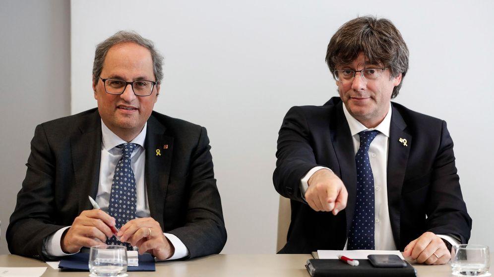 Foto: Quim Torra y Carles Puigdemont, en un acto de JxCAT en Bruselas. (EFE)