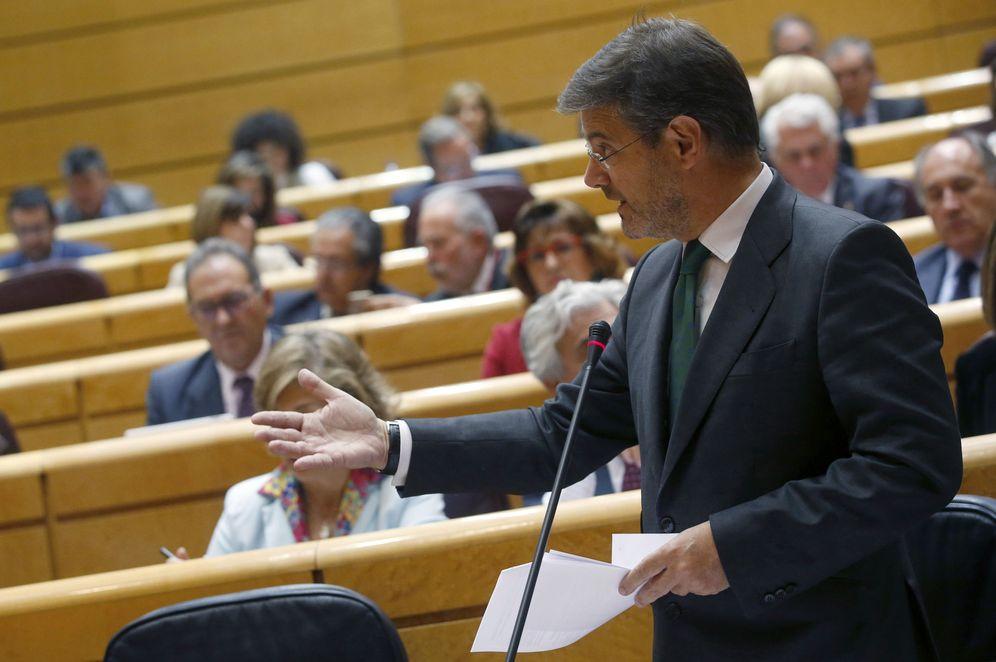 Foto: El ministro de Justicia, Rafael Catalá, durante la sesión de control al Gobierno en el Senado, este 25 de abril. (EFE)