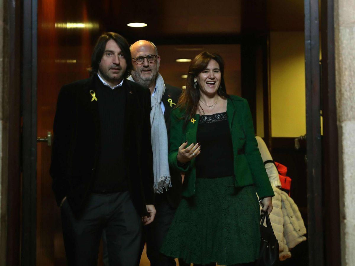 Foto: Los diputados de JxCAT Francesc Dalmases, Laura Borràs y Eduard Pujol. (EFE)